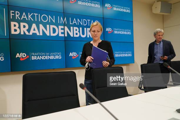 Lena Duggen and HansChristoph Berndt members of the rightwing Alternative for Germany political party in the Brandenburg state parliament arrive to...