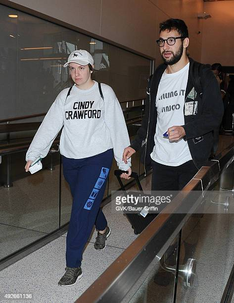Lena Dunham and Jack Antonoff are seen at LAX on October 14, 2015 in Los Angeles, California.