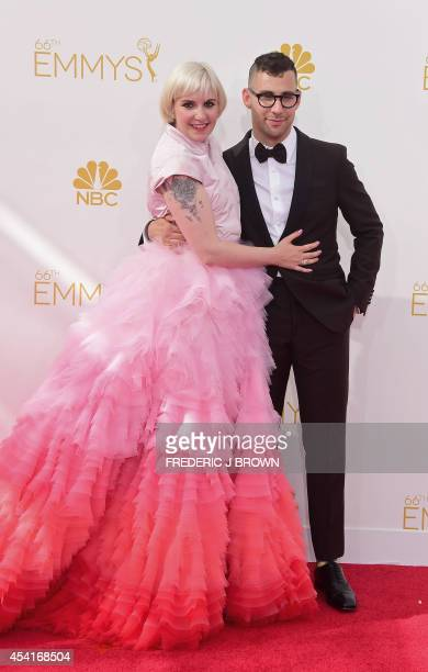 Lena Dunham and Jack Antonoff arrive on the red carpet for the 66th Emmy Awards, August 25, 2014 at Nokia Theatre in Los Angeles, California. AFP...