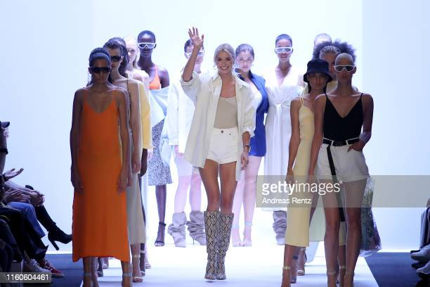 Lena Gercke acknowledges the applause of the audience after the LeGer by Lena Gercke fashion show during the AYFW - About You Fashion Week at ewerk...