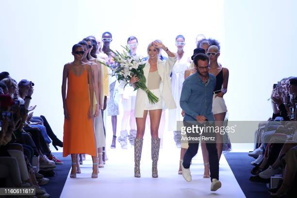 Lena Gercke acknowledges the applause of the audience after the LeGer by Lena Gercke fashion show during the AYFW About You Fashion Week at ewerk on...