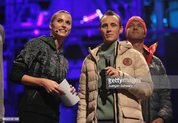 Lena Gercke and Eric Frenzel attend the presentation of the outfit for German athletes competing in the upcoming Olympic Games in South Korea 2018 at...
