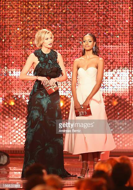 Lena Gercke and Sara Nuru speak on stage during 'BAMBI Awards 2012' at the Stadthalle Duesseldorf on November 22 2012 in Duesseldorf Germany