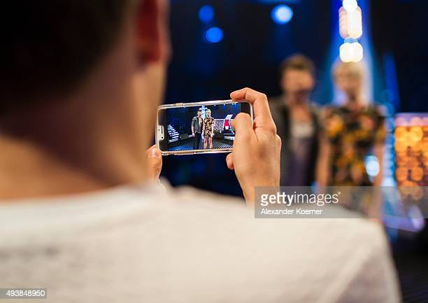 Lena Gercke and Thore Schoelermann are seen on the display of a smartphone during rehearsals for the television talent show 'The Voice of Germany' on...