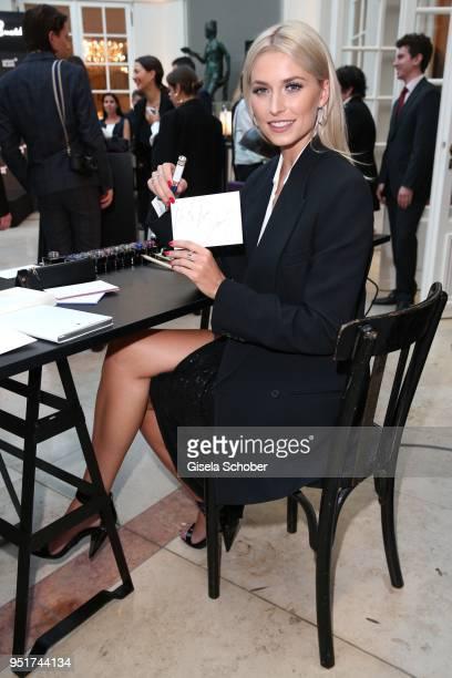 Lena Gercke Brand Ambassador Montblanc writes with a filler during the 27th Montblanc de la Culture Arts Patronage Award at Residenz on April 26 2018...