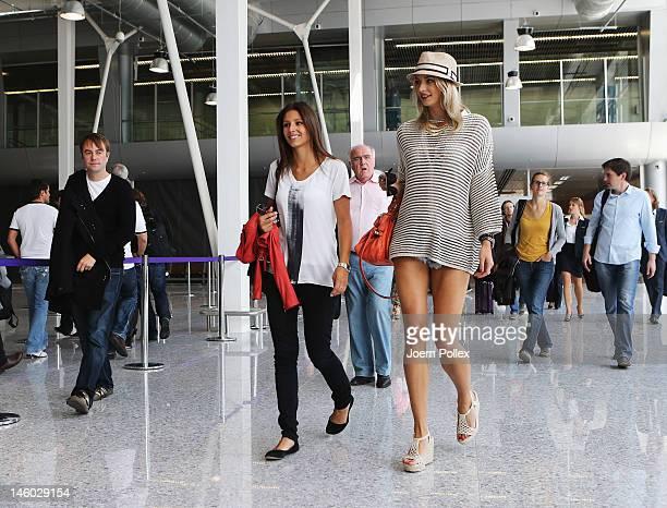 L'VIV UKRAINE JUNE 09 Lena Gercke girlfriend of Sami Khedira and Silvia Meichel girlfriend of Mario Gomez are seen at the airport Lviv on June 9 2012...