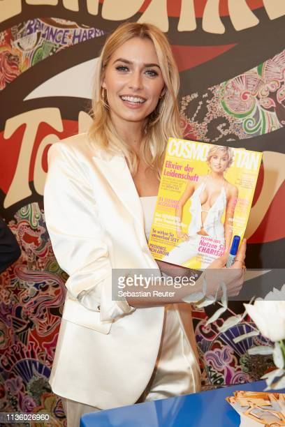 Lena Gercke poses with a copy of her fist magazine cover during the 'TommyxZendaya' meet greet event at KaDeWe on March 15 2019 in Berlin Germany