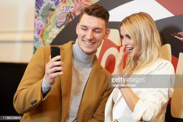 Lena Gercke poses with a fan during the 'TommyxZendaya' meet greet event at KaDeWe on March 15 2019 in Berlin Germany