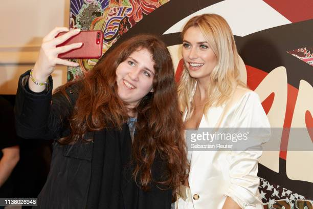 Lena Gercke poses with a fan during the TommyxZendaya meet greet event at KaDeWe on March 15 2019 in Berlin Germany
