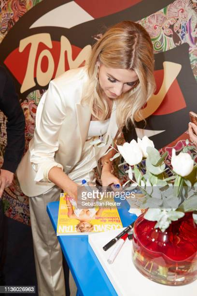 Lena Gercke signs a copy of her fist magazine cover during the 'TommyxZendaya' meet greet event at KaDeWe on March 15 2019 in Berlin Germany