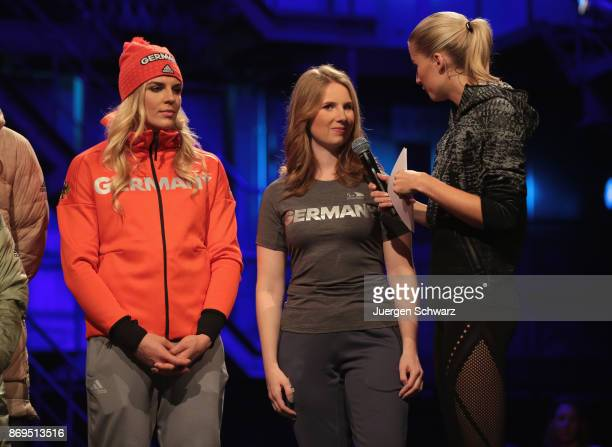 Lena Gercke stands beside Clara Klug during the presentation of the outfit for German athletes competing in the upcoming Olympic Games in South Korea...