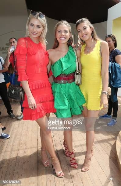 Lena Gercke, Victoria Swarovski and her sister Paulina Swarovski attend Magnum photocall during the 70th annual Cannes Film Festival at Magnum Beach...
