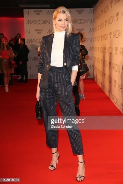 Lena Gercke wearing a black suit by Marc Cain during the Marc Cain Fashion Show Berlin Autumn/Winter 2018 at metro station Potsdamer Platz at on...