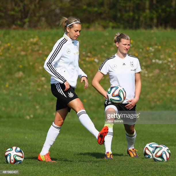 Lena Goessling and Alexandra Popp attend a Germany Women's training session at the Commerzbank Arena training ground on April 2 2014 in Frankfurt am...