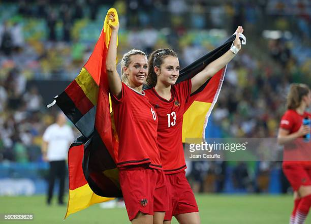 Lena Goessling and Sara Daebritz of Germany celebrate winning the gold medal the Women's Soccer Final between Germany and Sweden at Maracana Stadium...
