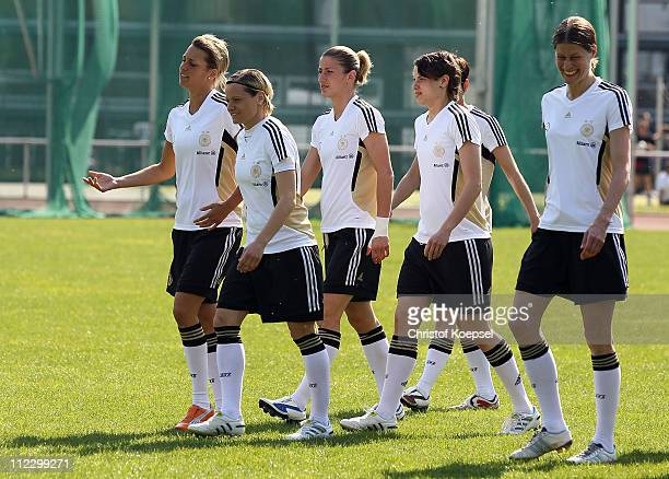Lena Goessling Martina Mueller Bianca Schmidt Ariane Hingst and Kerstin Garefrekes walk to the photo call and team presentation of Germany for the...