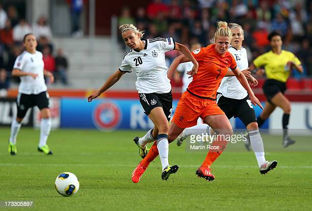 Lena Goessling of Germany battles for the ball with Kirsten van de Ven of Netherlands during the UEFA Women's Euro 2013 group B match at Vaxjo Arena...