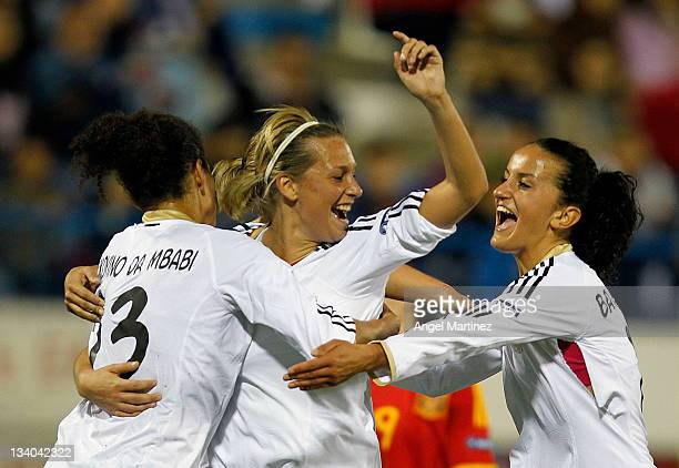 Lena Goessling of Germany celebrates with team mates Fatmire Bajramaj and Saskia Bartusiak after scoring her team's first goal during the Women's...