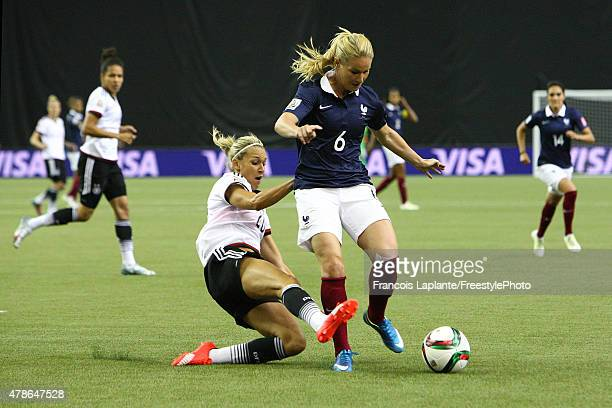 Lena Goessling of Germany challenges Amandine Henry of France during the FIFA Women's World Cup Canada 2015 quarter final match between Germany and...