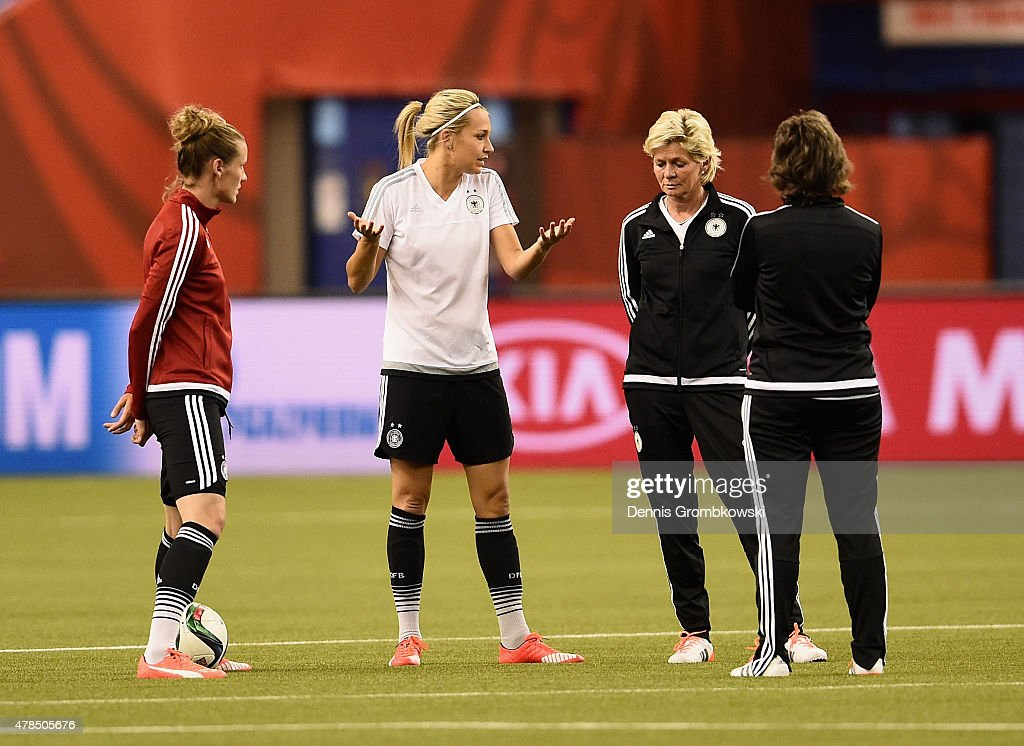 Lena Goessling of Germany exchanges words with head coach Silvia Neid during a training session at Stade Olympique de Montreal on June 25, 2015 in Montreal, Canada.