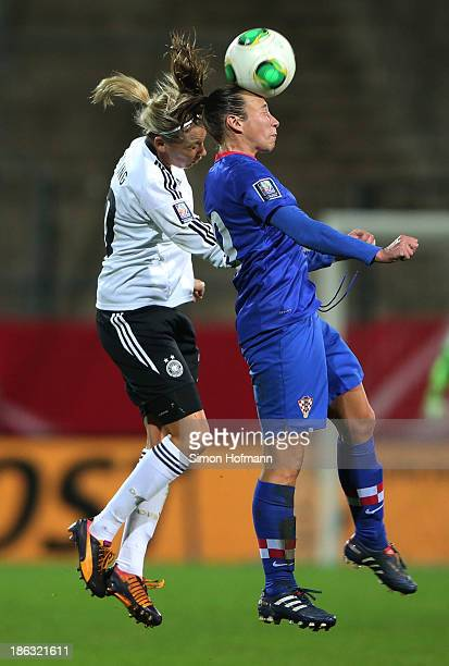 Lena Goessling of Germany jumps for a header with Sandra Zigic of Croatia during the FIFA Women's Worldcup 2015 Qualifier match between Germany and...
