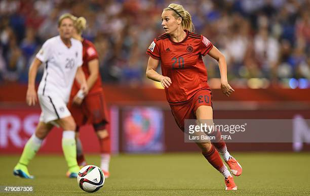 Lena Goessling of Germany runs with the ball during the FIFA Women's World Cup 2015 Semi Final match between USA and Germany at Olympic Stadium on...