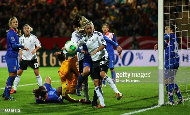 Lena Goessling of Germany tries to score against goalkeeper Doris Bacic of Croatia during the FIFA Women's Worldcup 2015 Qualifier match between...