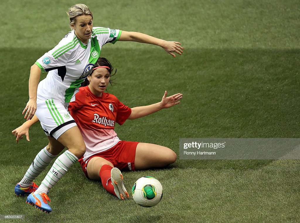 Lena Goessling (L) of VfL Wolfsburg and Sylvia Arnold of SC Freiburg battle for the ball during the DFB Women's Indoor Cup 2013 at GETEC-Arena on January 12, 2014 in Magdeburg, Germany.