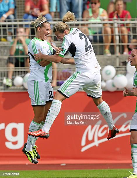 Lena Goessling of Wolfsburg jubilates with team mate Luisa Wensing after scoring the second goal during the Women's Bundesliga match between VFL...
