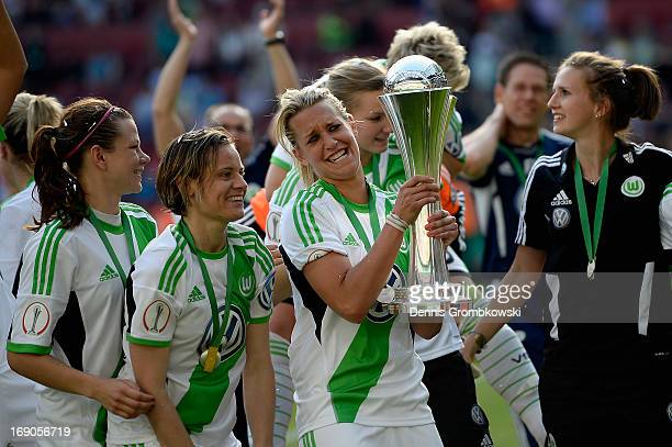 Lena Goessling of Wolfsburg lifts the trophy after winning the Women's DFB Cup Final between VfL Wolfsburg and 1 FFC Turbine Potsdam at Rhein Energie...