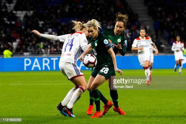Lena Groessling of Wolfsburg and Babett Peter of Wolfsburg and Hegerberg Ada of Lyon during the Women's Champions League match between Lyon and...