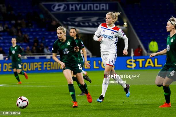 Lena Groessling of Wolfsburg and Hegerberg Ada of Lyon and Nilla Fischer of Wolfsburg during the Women's Champions League match between Lyon and...