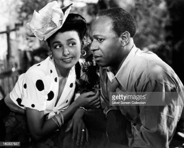 Lena Horne as Georgia Brown and Eddie Anderson as Little Joe Jackson in a promotional portrait for 'Cabin In The Sky' directed by Vincente Minnelli...