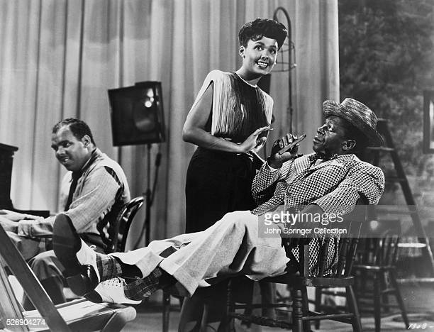 Lena Horne as Georgia Brown and Louis Armstrong as the Trumpeter in the 1943 film Cabin in the Sky.