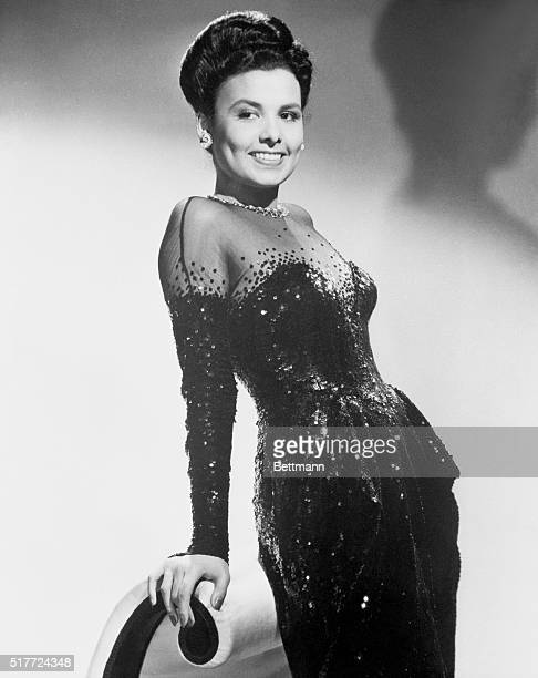 Lena Horne prominent singer of jazz who is also an actress poses in a sequined gown