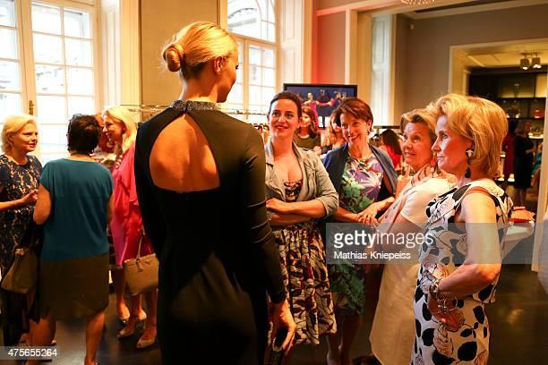 Lena Hoschek and Elisabeth Guertler watch a model during the Escada 'Fete Imperiale' 2015 on June 2 2015 in Vienna Austria