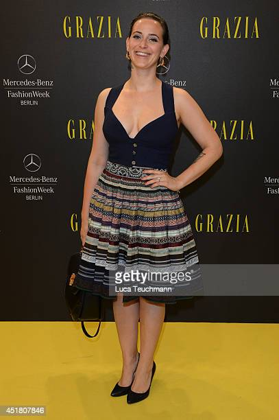 Lena Hoschek arrives for the Opening Night by Grazia fashion show during the MercedesBenz Fashion Week Spring/Summer 2015 at Erika Hess Eisstadion on...