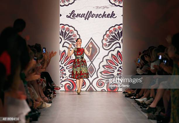 Lena Hoschek walks the runway at the Lena Hoschek show during the Mercedes-Benz Fashion Week Spring/Summer 2015 at Erika Hess Eisstadion on July 8,...