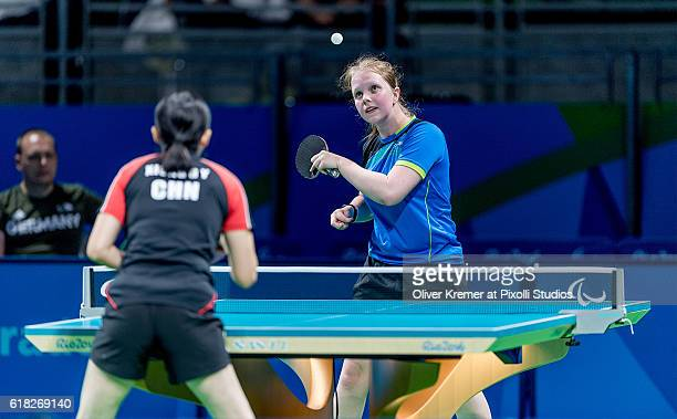 Lena Kramm of BSV München/Bayern [paralympic classification CL9] serving against Guiyan Xiong on Day 2 of the Rio 2016 Paralympic Games during the...