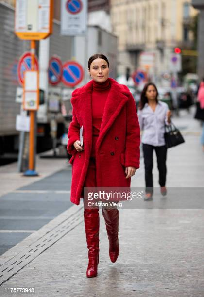 Lena Lademann is seen wearing red teddy coat, turtleneck, red pants, overknees boots outside the Max Mara show during Milan Fashion Week...