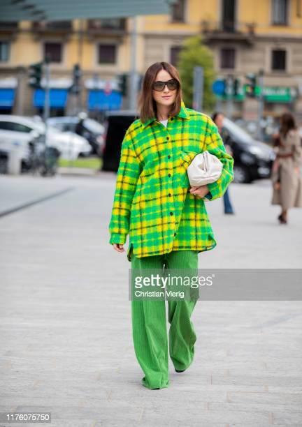 Lena Lademann seen wearing yellow green checkered flannel button shirt green pants Bottega Veneta pouch bag outside the Sportmax show during Milan...