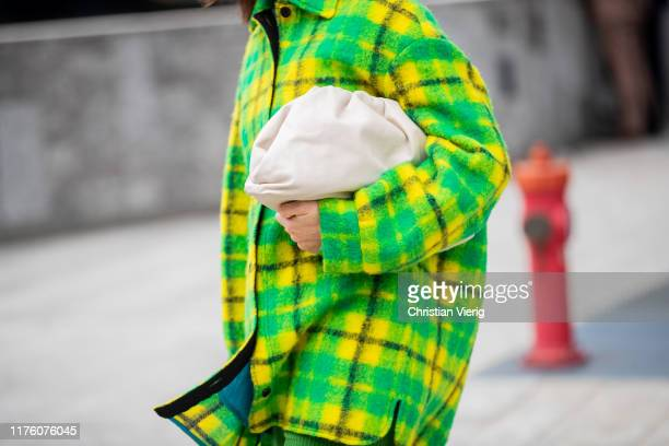 Lena Lademann seen wearing yellow green checkered flannel button shirt green pants Bottega Veneta pouch bag outside the Sportmax show during Milan...