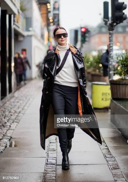 Lena Lademann weairng black vinyl coat outside Anne Vest during the Copenhagen Fashion Week Autumn/Winter 18 on January 31 2018 in Copenhagen Denmark