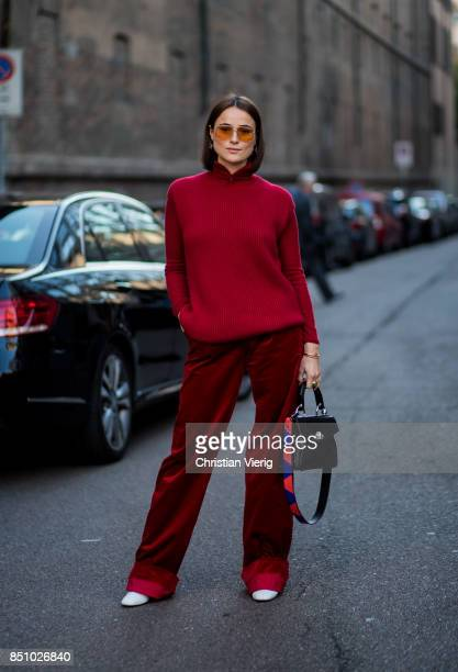 Lena Lademann wearing a red knit red velvet pants is seen outside Max Mara during Milan Fashion Week Spring/Summer 2018 on September 21 2017 in Milan...