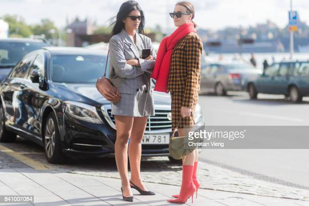 Lena Lademann wearing a red scarf yellow brown checked coat outside Stylein on August 30 2017 in Stockholm Sweden