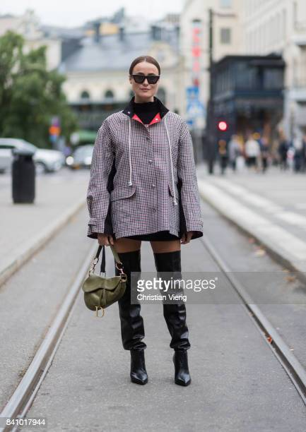 Lena Lademann wearing black overknees checked jacket outside Rodebjer on August 30 2017 in Stockholm Sweden