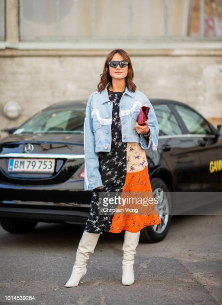 Lena Lademann wearing denim jacket black orange dress white boots seen outside Ganni during the Copenhagen Fashion Week Spring/Summer 2019 on August...