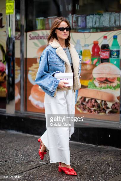 Lena Lademann wearing denim jacket white wide leg pants is seen outside 31 Phillip Lim during New York Fashion Week Spring/Summer 2019 on September...