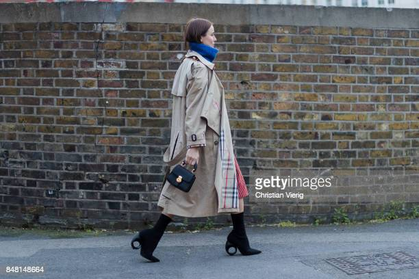 Lena Lademann wearing turtleneck trench coat outside Burberry during London Fashion Week September 2017 on September 16 2017 in London England