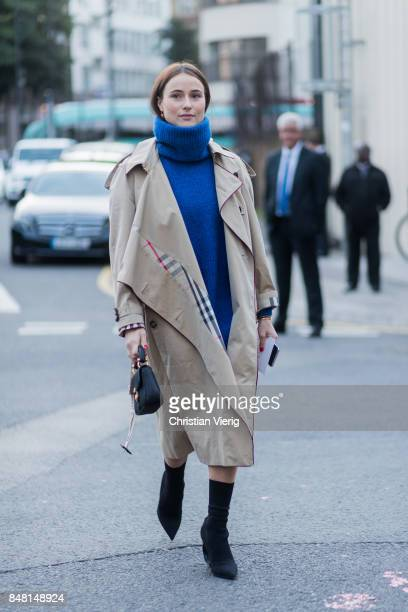 Lena Lademann wearing turtleneck, trench coat outside Burberry during London Fashion Week September 2017 on September 16, 2017 in London, England.